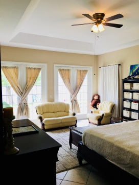Spacious master suite with a back wall of all french doors!